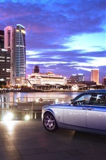 Preview iPhone wallpaper Rolls Royce luxury car rear view, city, night, lights