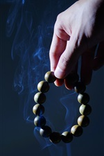 Preview iPhone wallpaper Rosary, hand