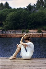 Preview iPhone wallpaper White skirt girl sit on the wood bridge, lake