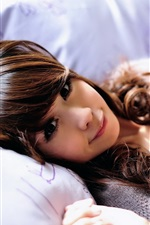 Preview iPhone wallpaper Asian girl and bear toy in bed