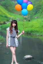 Asian girl, colorful balloons, stream