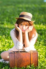 Preview iPhone wallpaper Asian girl, hat, suitcase, grass, sunshine