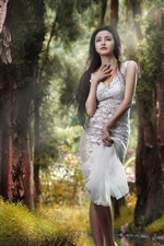 Asian girl in the forest, creek, water