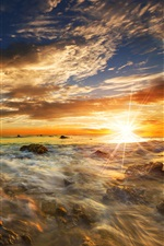 Preview iPhone wallpaper Beautiful sunset sea, stones, clouds, sun rays