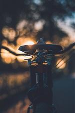 Bike seat at sunset