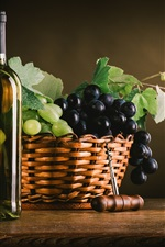 Black and green grapes, basket, wine