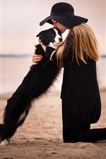 Preview iPhone wallpaper Black skirt girl and dog at beach