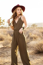 Preview iPhone wallpaper Blonde girl, jumpsuit, hat, grass