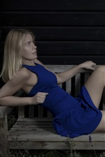 Blue dress girl rest on bench