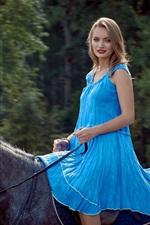 Preview iPhone wallpaper Blue skirt girl riding horse