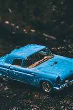 Preview iPhone wallpaper Blue toy car, water drops