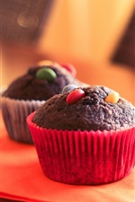 Preview iPhone wallpaper Chocolate cupcakes, table