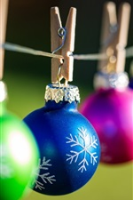 Preview iPhone wallpaper Colorful Christmas balls, clothespins, bokeh