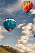 Preview iPhone wallpaper Colorful hot air balloon flight, sky, clouds