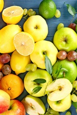 Preview iPhone wallpaper Delicious fruits, lemons, apples, grapes, oranges, yellow, green, red