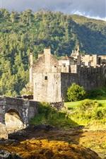 Preview iPhone wallpaper Eilean Donan Castle, Scotland, bridge, trees, clouds