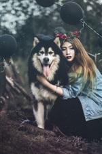 Girl and her husky dog