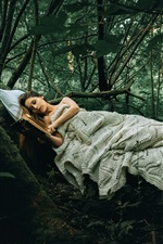 Preview iPhone wallpaper Girl sleep in the forest, read a book