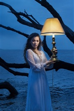 Preview iPhone wallpaper Girl standing in water, lamp, night