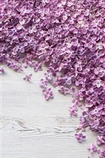 Preview iPhone wallpaper Many purple lilac flowers on wood board