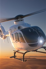 Preview iPhone wallpaper Multi-purpose light transport helicopter flight, dawn, sunrise