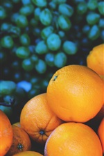 Preview iPhone wallpaper Oranges and grapes, blurry