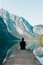 Preview iPhone wallpaper Pier, lake, mountains, lonely man