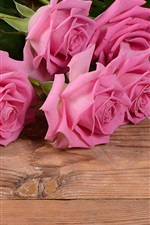 Preview iPhone wallpaper Pink rose on the wood board