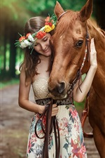 Smile girl and brown horse