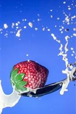 Strawberry, milk splash, spoon, blue background