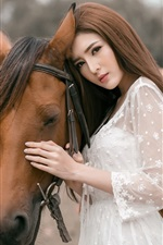 Preview iPhone wallpaper White skirt Asian girl and brown horse