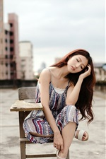 Preview iPhone wallpaper Asian girl sit on chair, roof