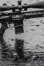 Preview iPhone wallpaper Assault rifle in rain, wet ground
