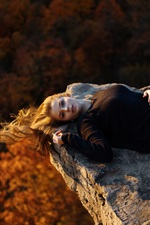 Preview iPhone wallpaper Black dress girl lying on stone