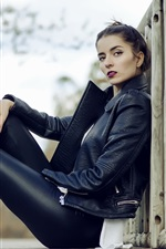 Black leather jacket girl, sit on ground