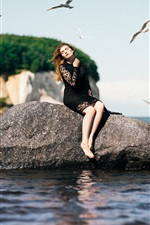 Preview iPhone wallpaper Black skirt girl sit on stone, sea, boat