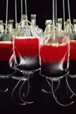 Preview iPhone wallpaper Blood bags, black background