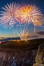 Preview iPhone wallpaper Cornwall, England, fireworks, sea, coast, dusk