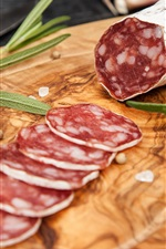 Preview iPhone wallpaper Delicious salami, sausage, cutting slice