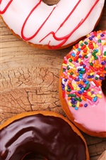 Preview iPhone wallpaper Donuts, wood board