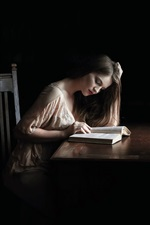 Preview iPhone wallpaper Girl read book in dark house