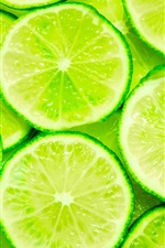 Preview iPhone wallpaper Green lemon slices close-up