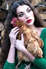 Preview iPhone wallpaper Green skirt girl hug a chicken, makeup, snowy