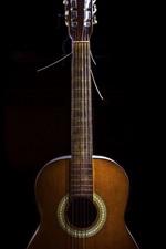 Guitar, black background