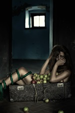 Lonely girl in suitcase, apples, room