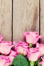 Preview iPhone wallpaper Pink roses, wood background