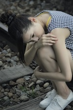 Preview iPhone wallpaper Sadness Asian girl, railroad