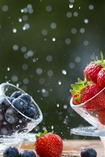 Preview iPhone wallpaper Strawberry and blueberry, glass cup, water drops