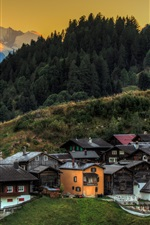 Preview iPhone wallpaper Switzerland, church, trees, slope, mountains, town, dusk