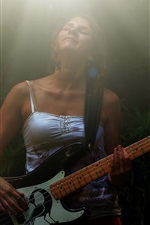 Woman play guitar, light rays